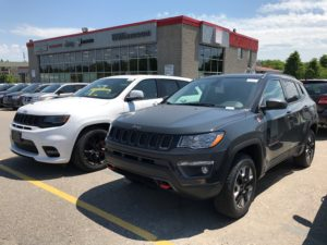 The All-New 2017 Jeep Compass Trailhawk next to its big brother, 2017 Jeep Grand Cherokee SRT
